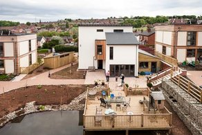 If I Had a Hammer... The LILAC common house and pond. Courtesy Andy Lord