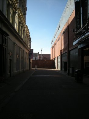 The Missing City Berry Street - with a brick wall blocking off West Belfast. Photo Vicky Richardson