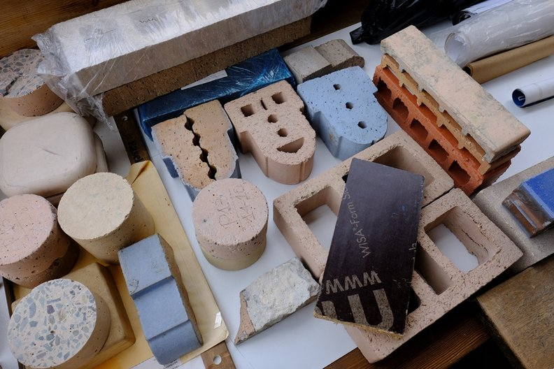 Digging Through Bricks & Other Material Samples in Rogeli Salmona's Office © Dominic Oliver Dudley