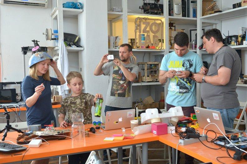 Workshop particpants working on their designs