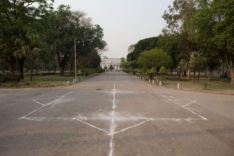 'Chalk outline illustrating scale and site of marble compass at Bagh-e-Jinnah, Lahore'   Photograph courtesy Matt Kushan