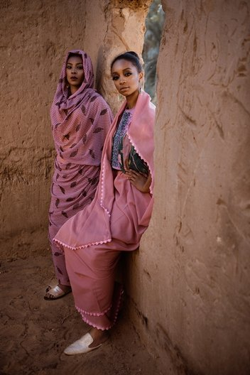 Photographer Maimana Mohammed Abbas Bona (L) and Izy (R) wear full looks stylist's own