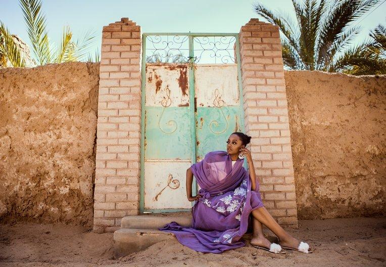 Photographer Maimana Mohammed Abbas Izy wears purple toub by Tiab Habab
