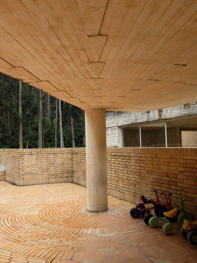 Play terrace and eucalyptus forest beyond, Jardin Infantil San Jeromino del Yuste © Freya Cobbin