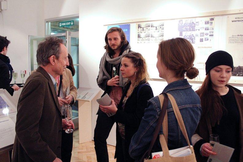 Richard Hollis talks to exhibition visitors. Photo: Alice Masters