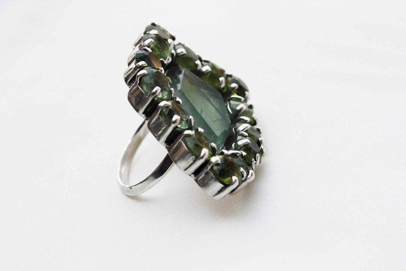Ring. Vicki Sarge for Turquoise Mountain. Silver. Moonstone, peridot. Makers, TM graduate collective: Blue Diamond