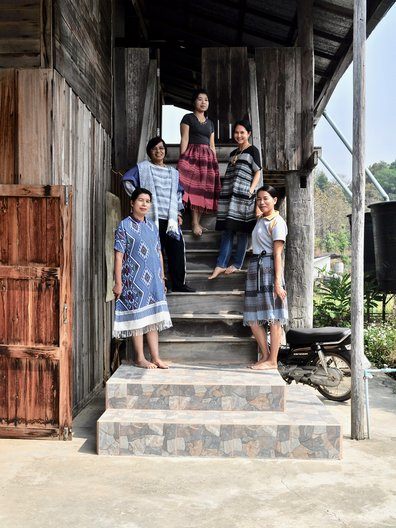 The women at Ban Don Chai wearing garments made from their own woven fabric. Image courtesy Alison Welch