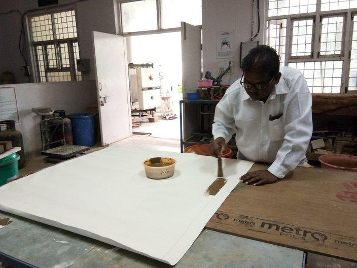 Ramesh Hengadi preparing a canvas at the Indian Institute of Craft and Design, Jaipur