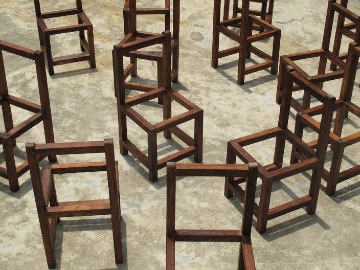 Photo: WORKSHOP Architecture The frames of chairs given to each family to complete using the traditional craft of jute weaving.