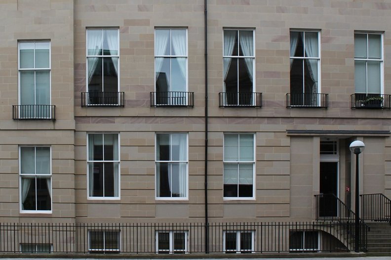 Large sliding windows, St Vincent Place, Edinburgh; not cleanable as per requirements of BS8213. Photograph by Liam Ross