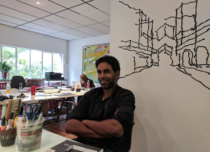 Thiresh Govender, architect Urban Works in front of a drawing by Lorenzo Nassimbeni © Kate Goodwin