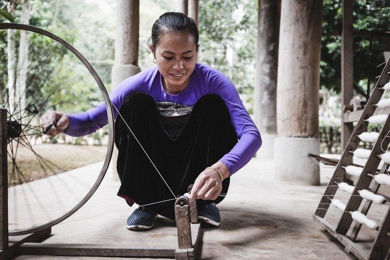 Spinning hemp yarn In Lao Chai Village, Sapa, Vietnam. Photo by Nic Shonfeld