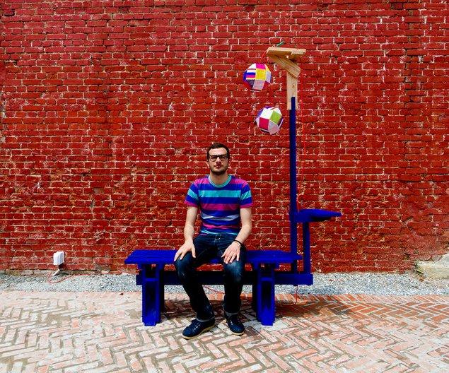 Fabien Cappello with part of his outdoor furniture. Photo: Igor Tyuterev
