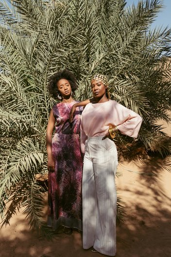 Photographer Maganga Mwango  Izy (L) wears full look by Anyango Mpinga, earrings and ring by Ashrenkail, shoes by Walaa. Bona (R) wears top by Nucy, trousers by Anyango Mpinga, bracelet by Ami Doshi Shah