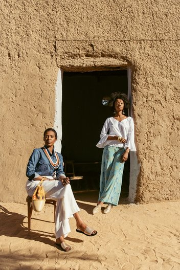 Photographer Maganga Mwango  Bona (L) wears shirt & bag by Haute Baso, trousers by Nucy and shoes by Walaa. )Izy (R) wears shirt by Boutique De Nana, trousers by Anyango Mpinga and earrings by Ami Doshi Shah